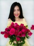 Menina bonita com rosas Imagens de Stock