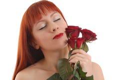 Menina bonita com rosas fotografia de stock royalty free