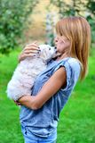 Menina bonita com seu cão Fotos de Stock