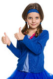 Menina bonita com seus polegares acima Fotos de Stock
