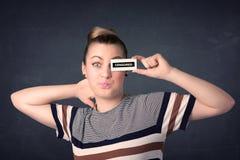 Menina bonita com sinal de papel censurado Imagem de Stock Royalty Free