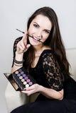 Menina bonita com sombra e escova Foto de Stock Royalty Free