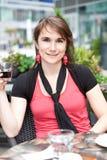 Menina bonita com sua bebida Foto de Stock Royalty Free