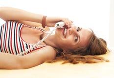Menina bonita com telefone Fotografia de Stock Royalty Free