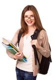 Menina bonita com trouxa e cadernos Imagens de Stock Royalty Free