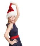 Menina bonita com um chapéu de Santa fotos de stock