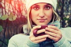 Menina bonita com um copo Imagem de Stock Royalty Free