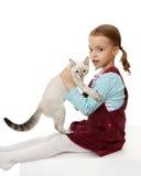 Menina bonita com um gatinho. Foto de Stock