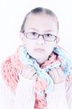 menina bonita com um lenço morno no pescoço fotos de stock royalty free