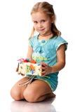 Menina bonita com um presente Fotos de Stock