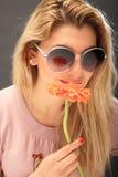 Menina bonita com uma flor foto de stock royalty free