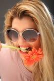 Menina bonita com uma flor fotografia de stock royalty free
