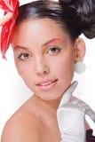 Menina bonita com uma flor vermelha e no glov branco Fotografia de Stock Royalty Free
