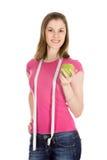 Menina bonita com uma maçã. Isolado Foto de Stock