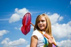 Menina bonita com uma rede da borboleta Imagens de Stock
