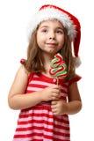 Menina bonita de Santa com lollipop do Natal Imagem de Stock