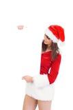 Menina bonita de Santa que guarda o cartaz Foto de Stock Royalty Free
