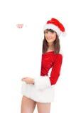 Menina bonita de Santa que guarda o cartaz Imagem de Stock Royalty Free