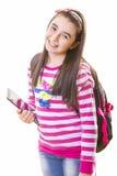 Menina bonita do adolescente com trouxa e a tabuleta digital Imagens de Stock