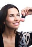 Menina bonita do brinette com escova da composição Imagens de Stock Royalty Free