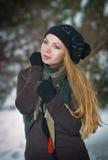 Menina bonita do cabelo louro na roupa do inverno Imagem de Stock Royalty Free