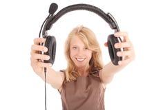 Menina bonita do estudante do operador do serviço ao cliente com auriculares imagens de stock