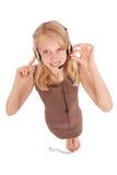 Menina bonita do estudante do operador do serviço ao cliente com auriculares Imagem de Stock