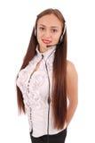 Menina bonita do estudante do operador do serviço ao cliente com headse Foto de Stock Royalty Free