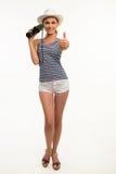 Menina bonita do marinheiro com os polegares-acima de doação binoculares Fotos de Stock