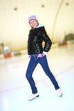 Menina bonita em patins Fotografia de Stock Royalty Free
