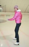 Menina bonita em patins Foto de Stock