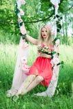 Menina bonita em um balanço Fotografia de Stock