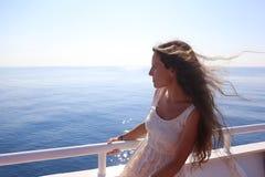 Menina bonita em um barco Fotos de Stock