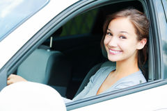 Menina bonita em um carro foto de stock royalty free