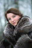 Menina bonita em um casaco de pele Imagens de Stock