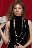 Menina bonita em um fundo vermelho Imagem de Stock Royalty Free