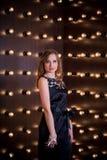 Menina bonita em um interior incomum Foto de Stock Royalty Free