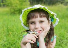 Menina bonita em um prado Imagem de Stock