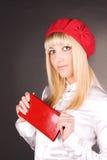 Menina bonita em um tampão vermelho Foto de Stock Royalty Free