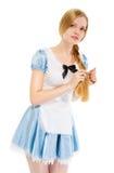 Menina bonita em um vestido azul, suas tranças do cabelo foto de stock