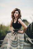 Menina bonita em um vestido longo foto de stock