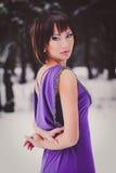 Menina bonita em um vestido roxo longo foto de stock royalty free