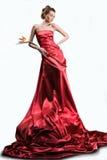 A menina bonita em um vestido vermelho longo Imagens de Stock