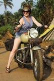 Menina bonita em uma bicicleta fotos de stock royalty free