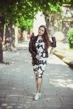 Menina bonita em uma caminhada Fotos de Stock