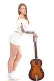 Menina bonita em uma camisola com guitarra Fotos de Stock Royalty Free