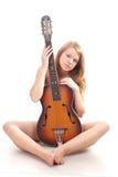 Menina bonita em uma camisola com guitarra Fotografia de Stock