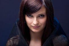 Menina bonita em uma imagem de uma bruxa Fotos de Stock Royalty Free