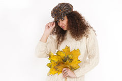Menina bonita em uma ligação em ponte e em um chapéu Fotos de Stock Royalty Free