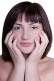 A menina bonita está fazendo massagens sua face Fotografia de Stock Royalty Free
